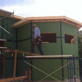 Putting up soffit.